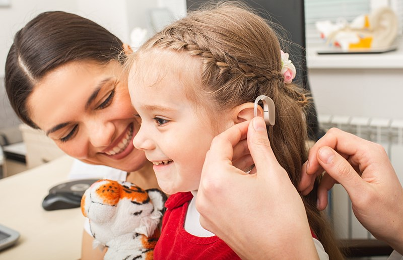 Image of a young girl wearing a hearing aid